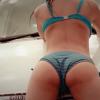 Girls washing a car in bikini's